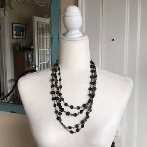 Brassy multi-stranded flat disc necklace